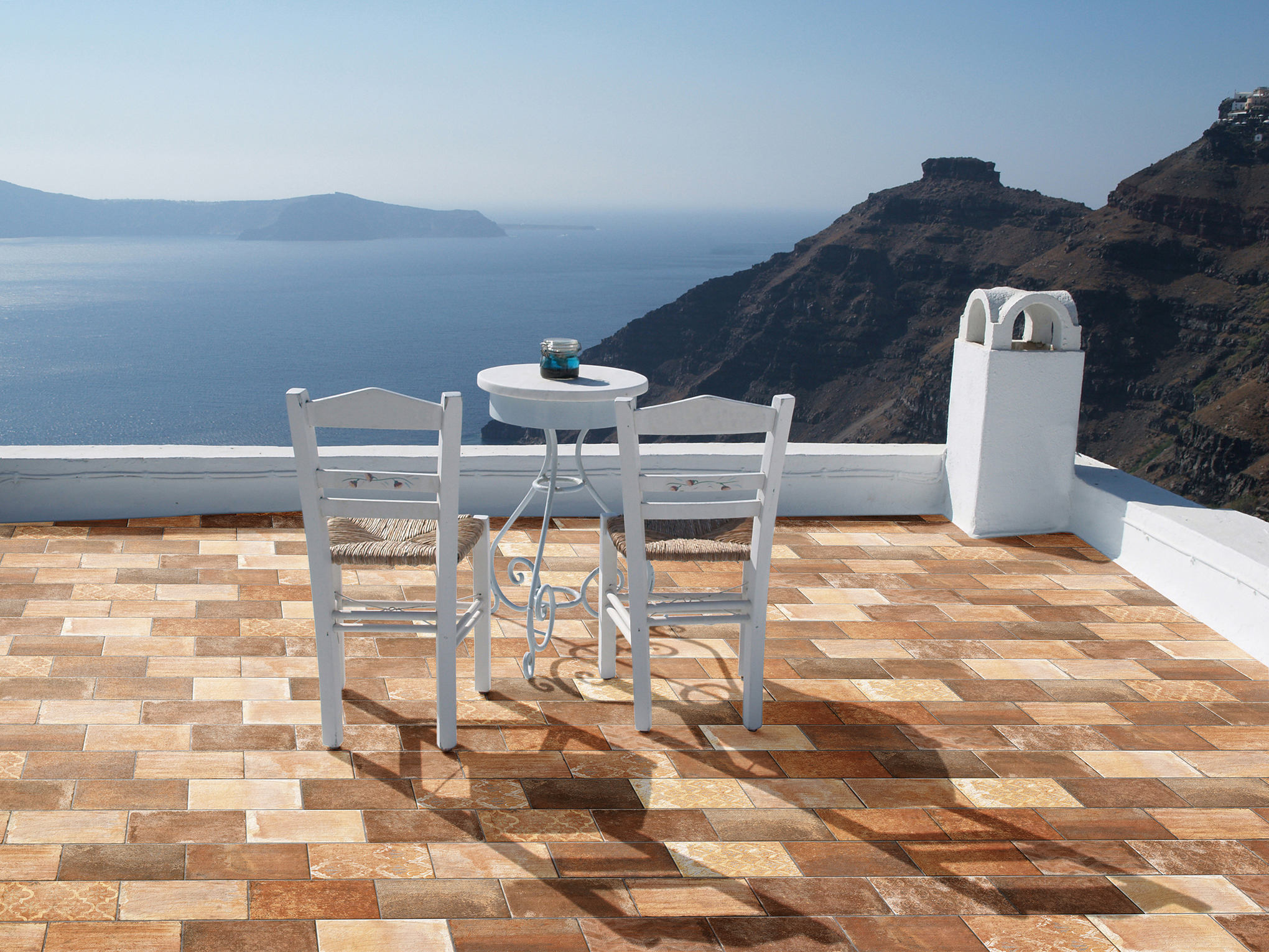 White Table on terrace overlooking the mediterranean sea